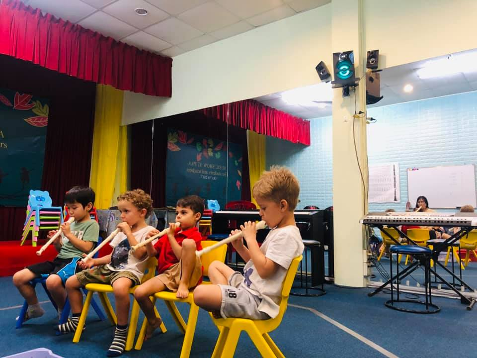 Kids playing instruments at PAA