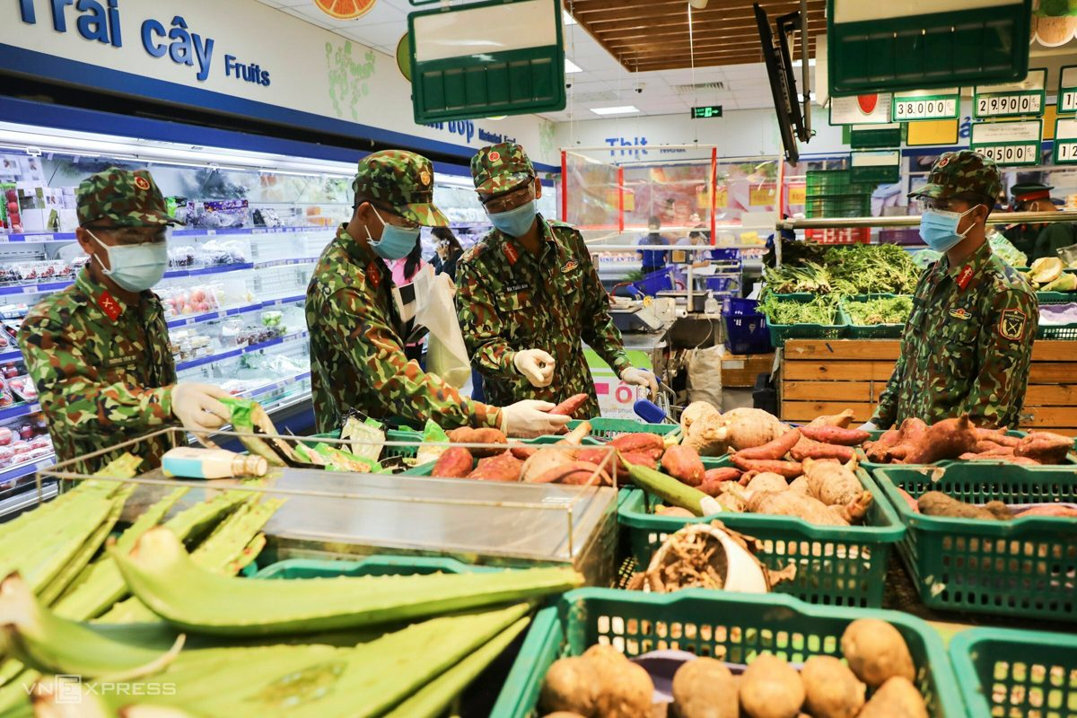 soldiers pick veggies at a supermarket