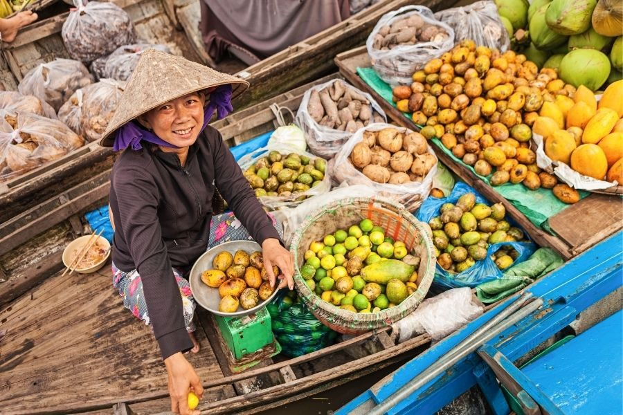 Boat with fruits on   Mekong delta