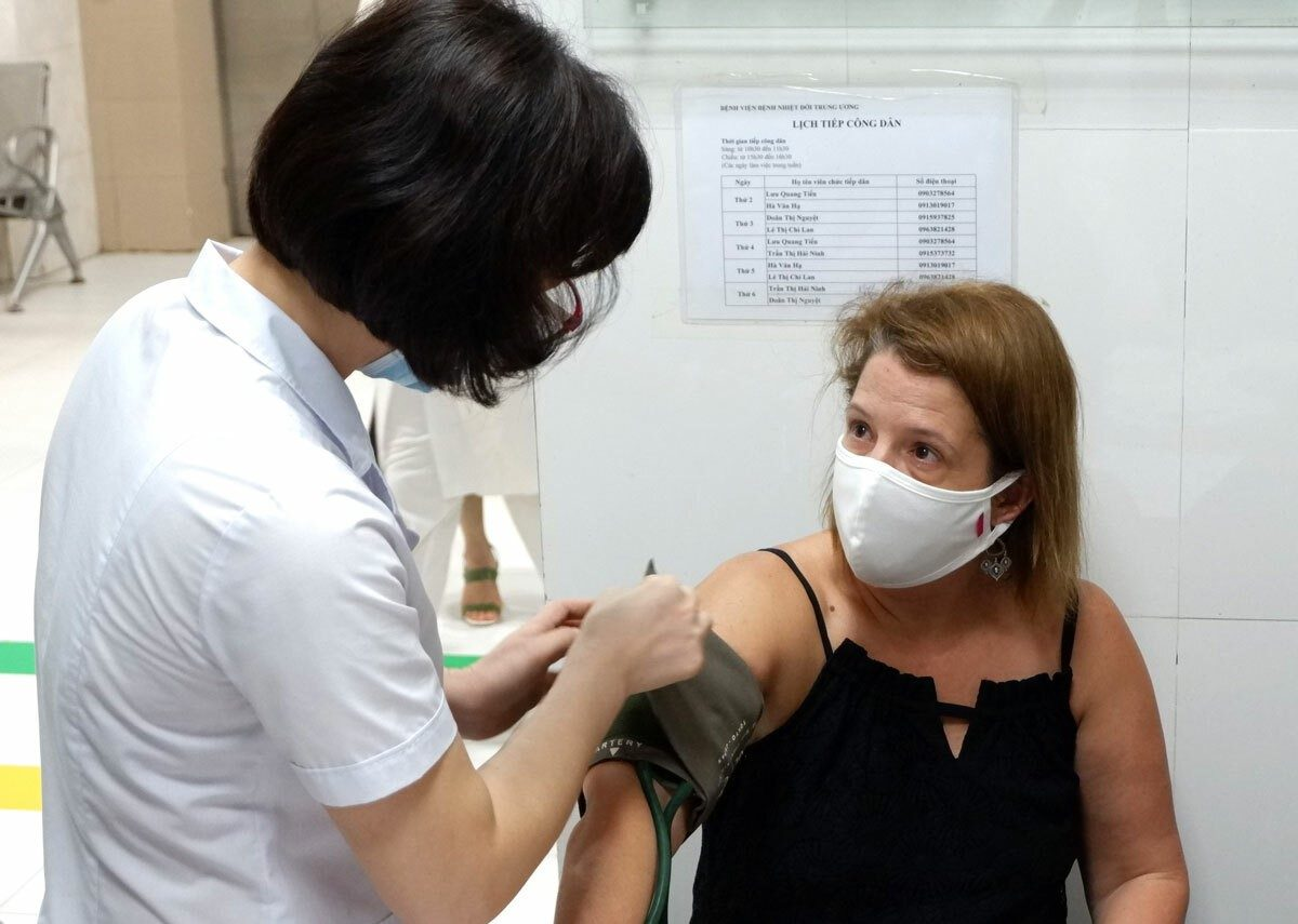 An American woman has her blood pressure taken before donating her plasma at the National Hospital for Tropical Diseases in Hanoi