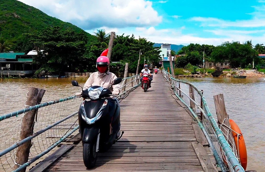 Motorbike ride over a wooden xylophone bridge, Nha Trang.